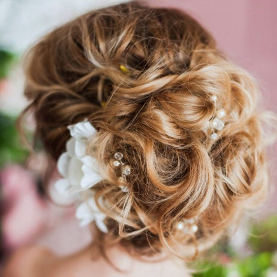 woman with a curly hair updo