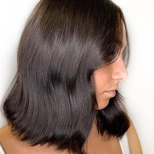 woman with dark chocolate hair color