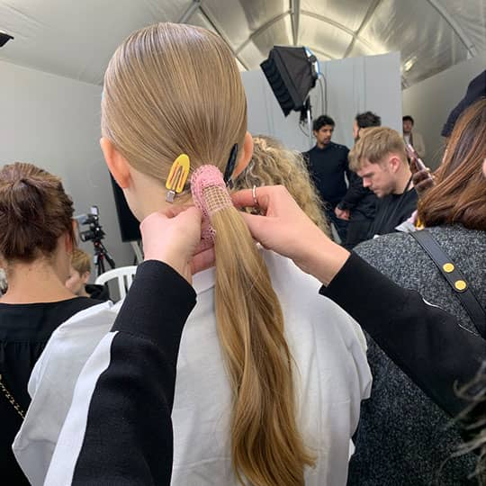 woman with low ponytail at paris fashion week