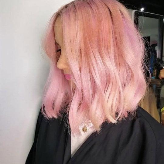 woman wiith peach hair color bob