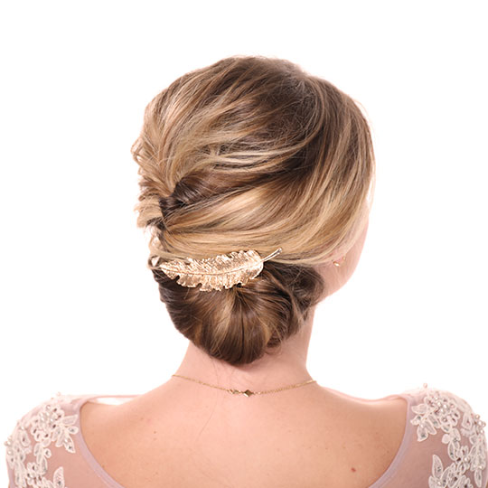 woman's updo back view with gold feather clip