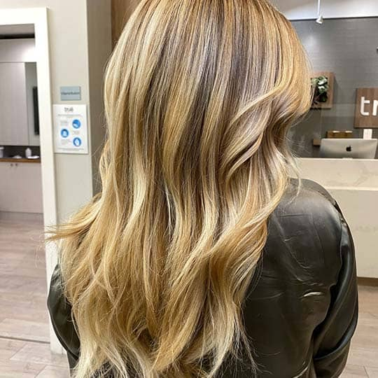 photo of butter blonde hair color using redken shades eq