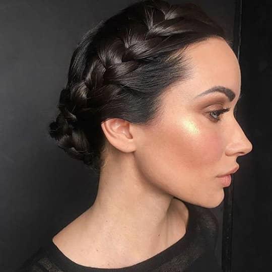 woman with sleek braided chignon hair