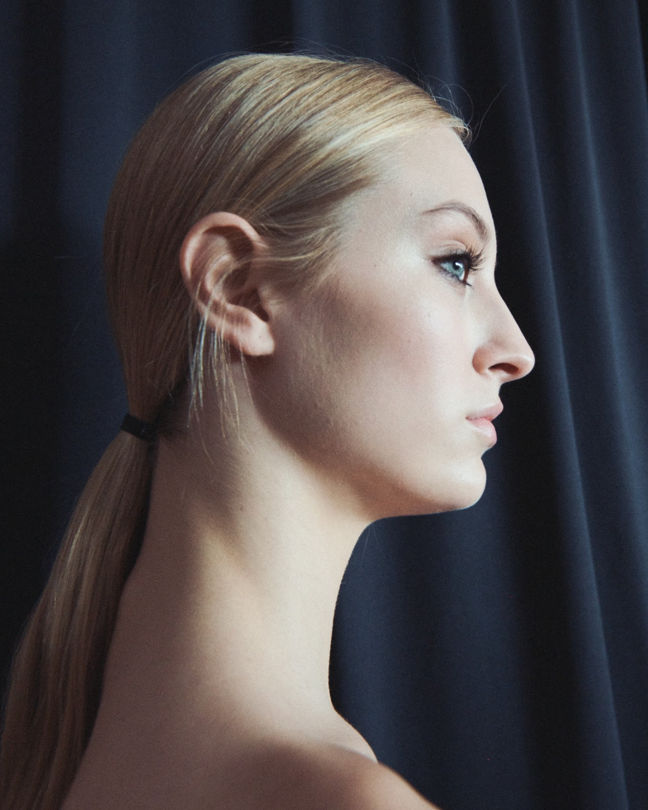 Woman with 70's inspired ponytail at NYFW