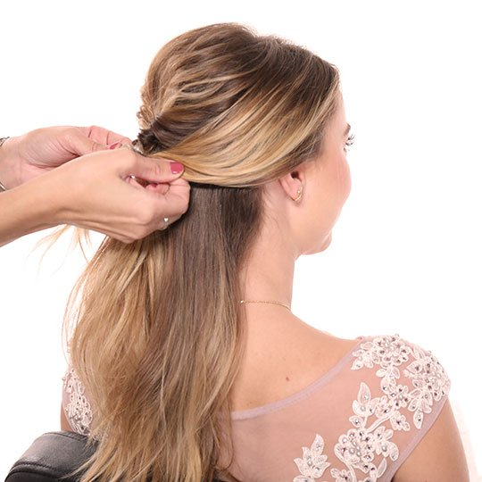 hand holding section of woman's hair