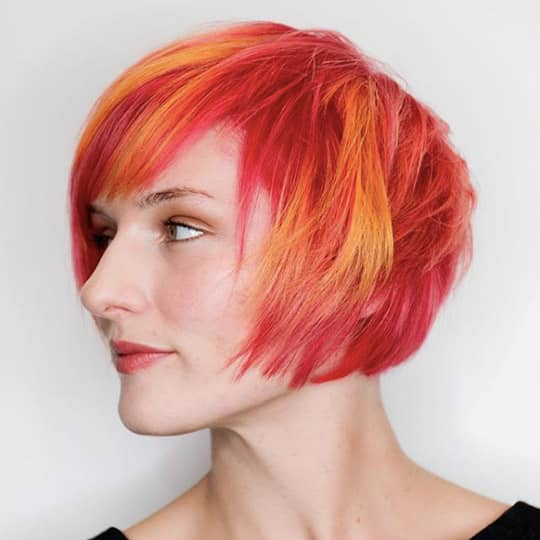 photo of woman with asymmetrical bob with bangs