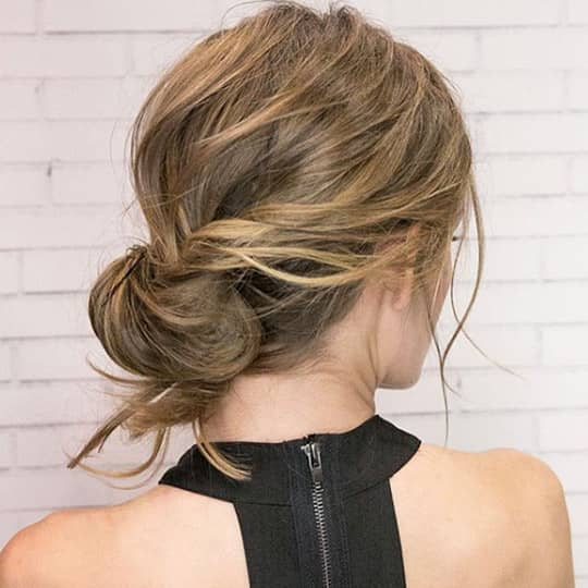 Woman with messy chignon updo