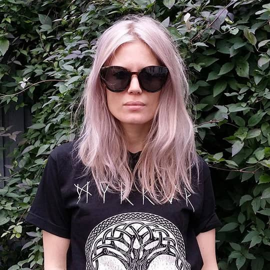 photo of woman with blush smoky hair color