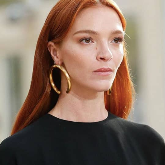 red haired woman at paris fashion week