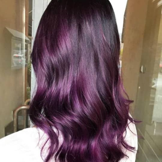 Woman with eggplant hair color