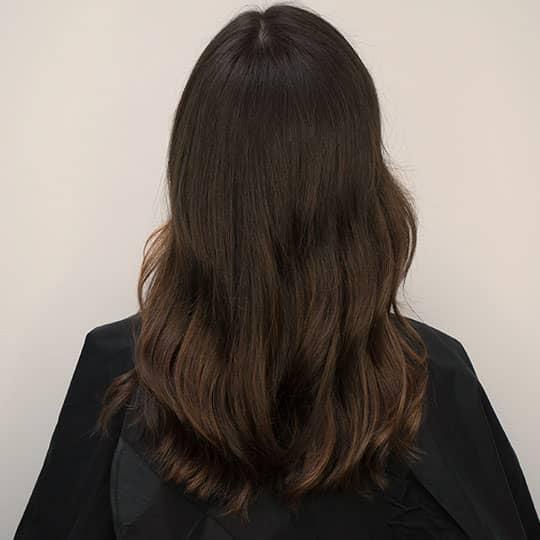 highlighted balayage hair from behind