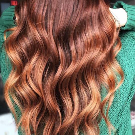 woman with long balayage red hair