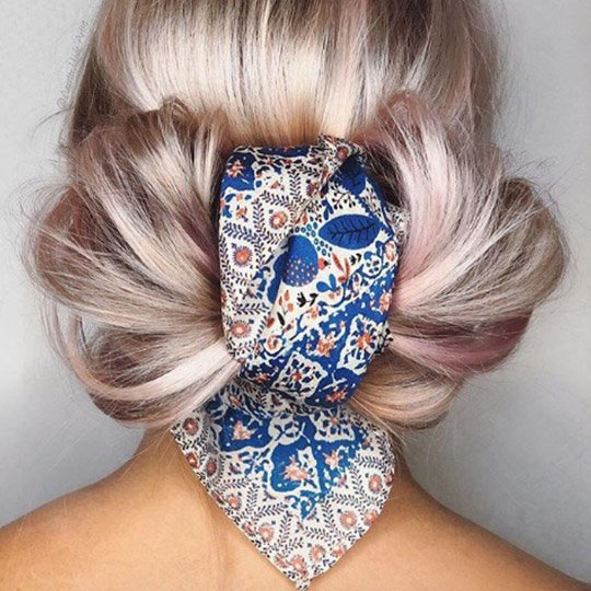 festival hairstyles  decorated bow tie bun