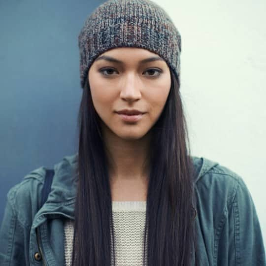 Woman with long straight hair wearing hat