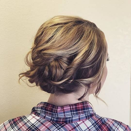 woman with widswept updo hairstyle