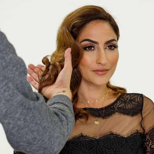 Woman getting brown hair styled