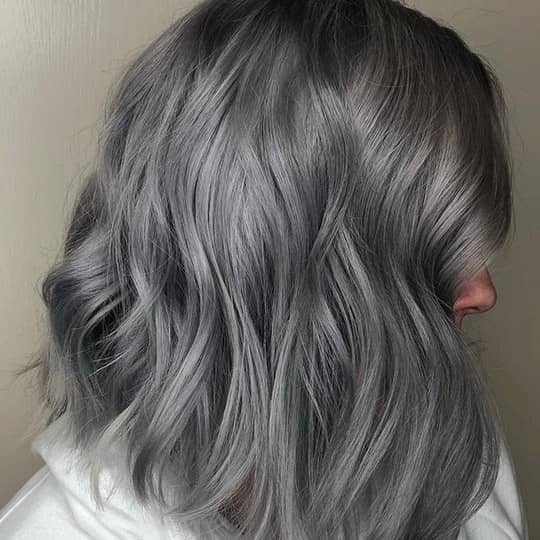 photo of woman with charcoal smoky hair color