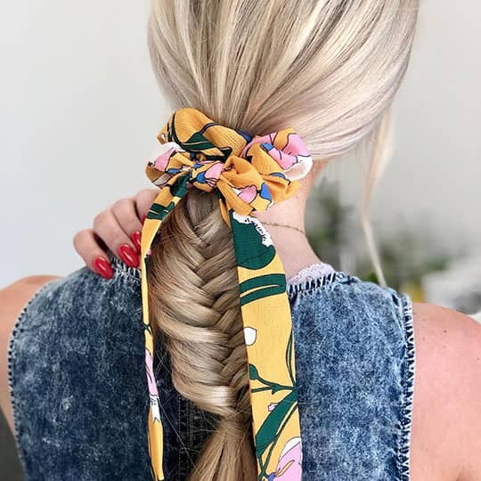 blonde with loose side braid hairstyle for work