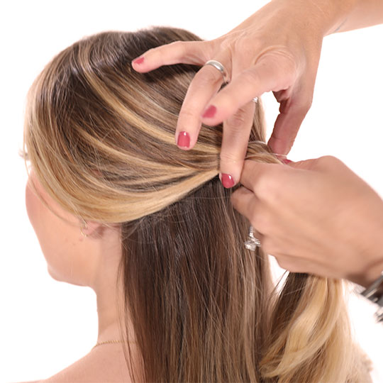 hand holding half a woman's hair