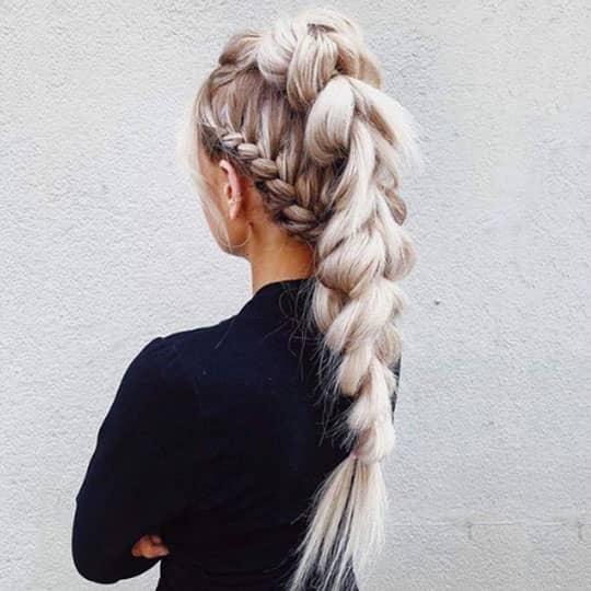 women with long blonde braid