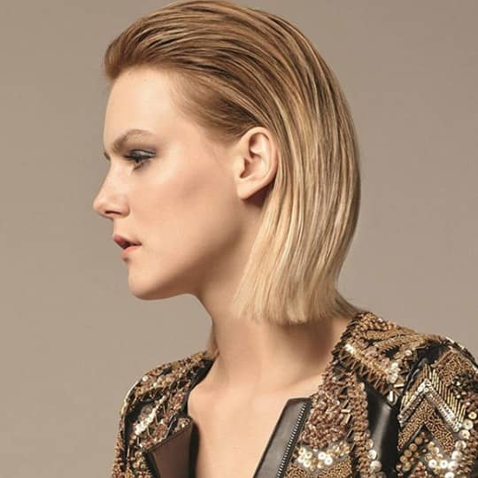 Woman with slicked back roots hair
