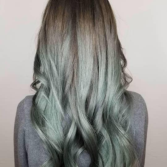 photo of woman with green smoky hair color