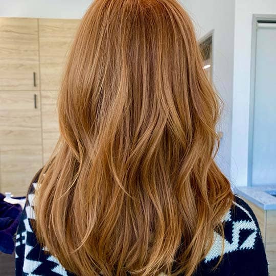 photo of copper blonde hair color using redken shades eq