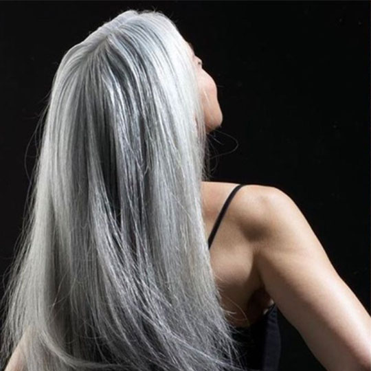 back of woman with long grey hair