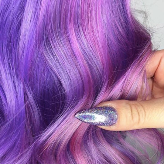 purple finger nail holding purple hair
