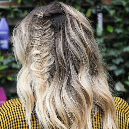 accent side fishtail braid festival hairstyle