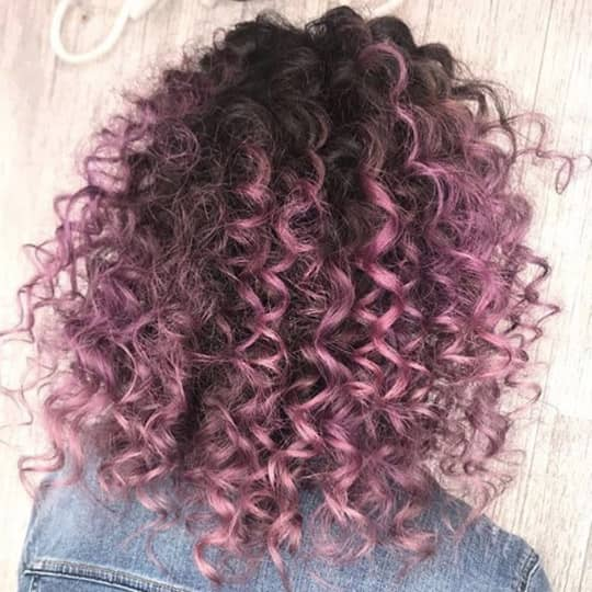 woman with curly purple hair