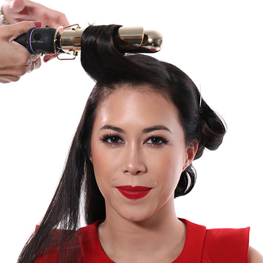 curling iron around front section of hair for old hollywood waves style