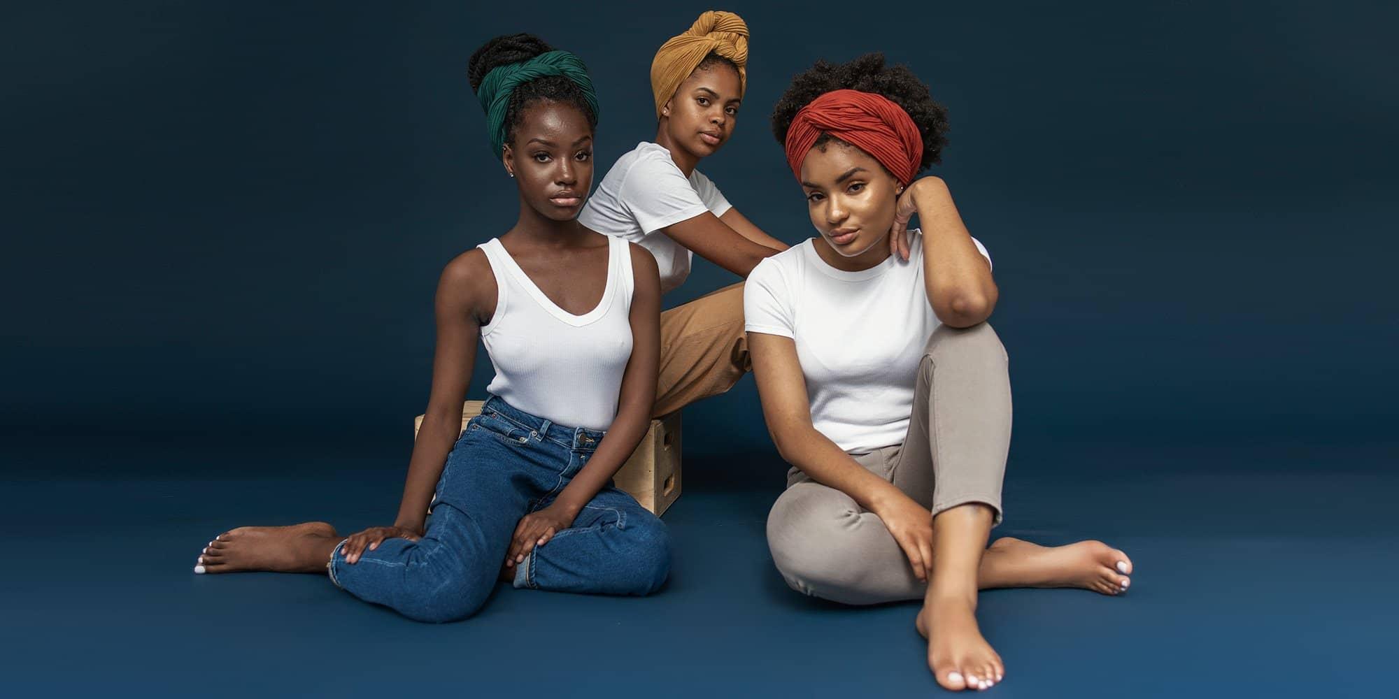 three women wearing the wrap life head wraps