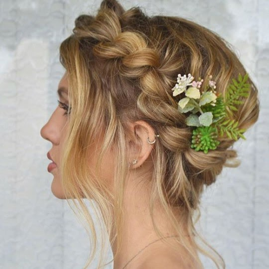 blonde woman with a crown braid and flowers