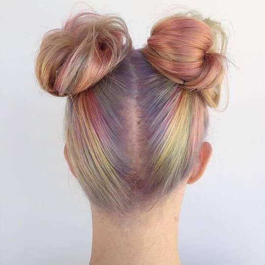 Girl with rainbow space buns