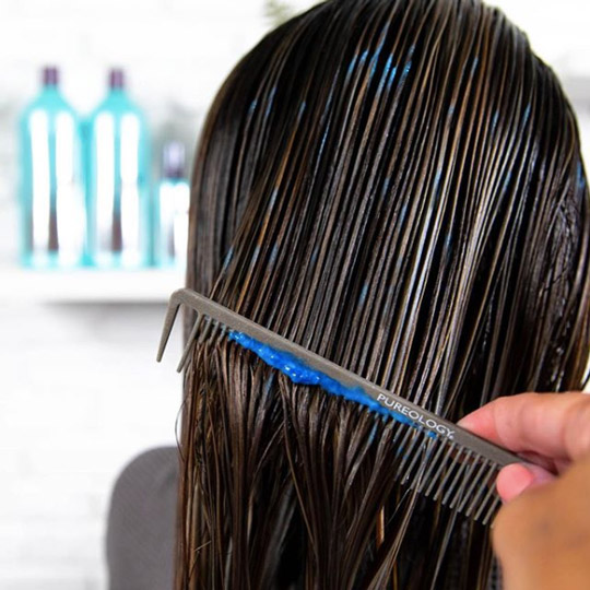damaged hair getting a deep conditioning treatment
