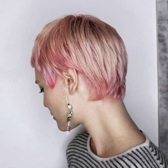 woman with pink pixie to look younger