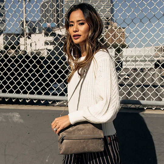 jamie chung posing outside with wavy hair