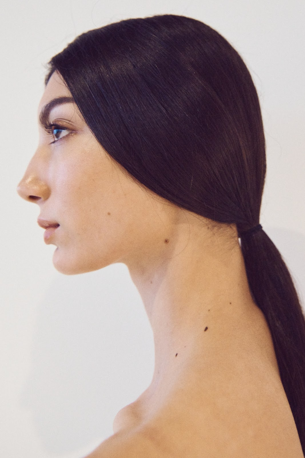 Woman with low ponytail at NYFW 2020