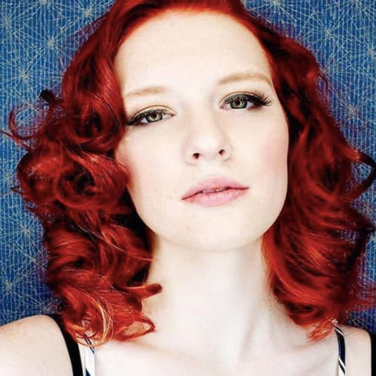 Woman with big barrel curls hairstyle