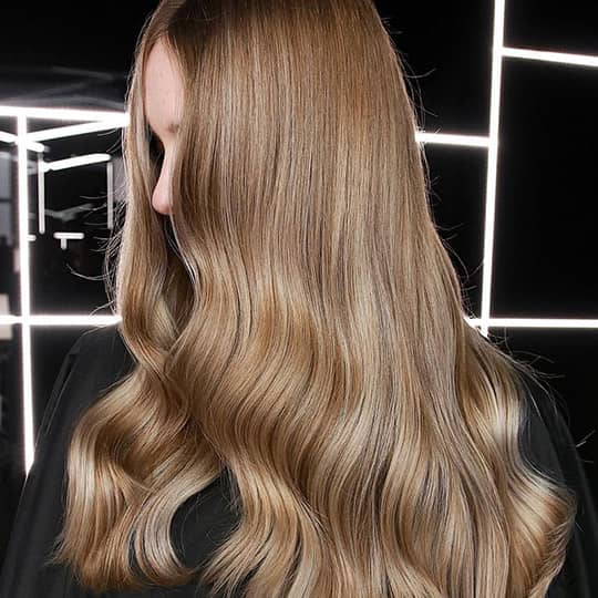 photo of woman with subtle honey highlights