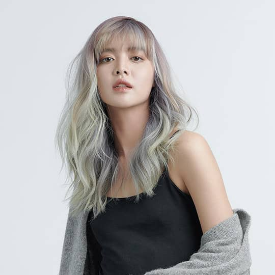 photo of woman with rainbow smoky hair color