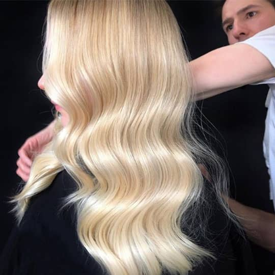 man styling woman with airtouch technique balayage