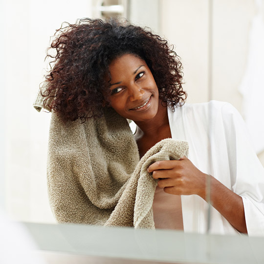 woman drying her curly hair