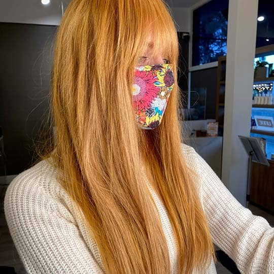 photo of ginger orange hair color using redken shades eq