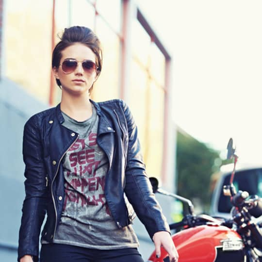 Photo of biker woman with a mini-pompadour hairstyle